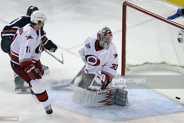 Shawn Horcoff of the Edmonton Oilers scores a goal past goaltender Cam Ward of the Carolina Hurricanes during game six of the 2006 NHL Stanley Cup...