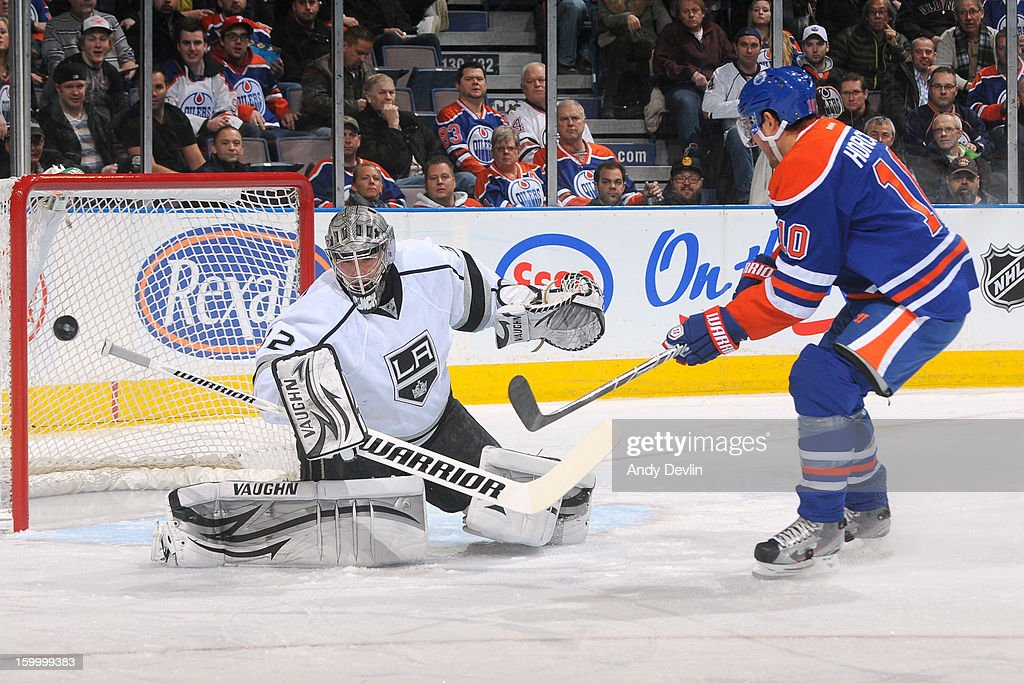 Shawn Horcoff #10 of the Edmonton Oilers takes a shot on Jonathan Quick #32 of the Los Angeles Kings in a game between the Edmonton Oilers and the Los Angeles Kings at Rexall Place on January 24, 2013 in Edmonton, Alberta, Canada.