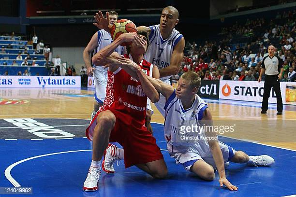 Shawn Huff of Finland and Sasu Salin of Finland defend against Andrei Kirilenko of Russia during the EuroBasket 2011 second round group B match...