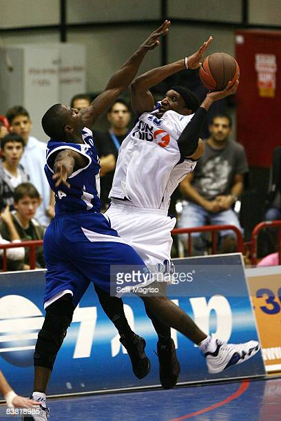 Shawn James #15 of Bnei Hasharon competes with Michael Wright #7 of Turk Telekom during the Eurocup Basketball Game 1 match between Bnei Eshet Tours...