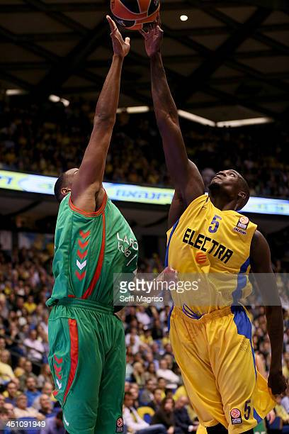 Shawn James #5 of Maccabi Electra Tel Aviv competes with Lamont Hamilton #11 of Laboral Kutxa Vitoria during the 20132014 Turkish Airlines Euroleague...