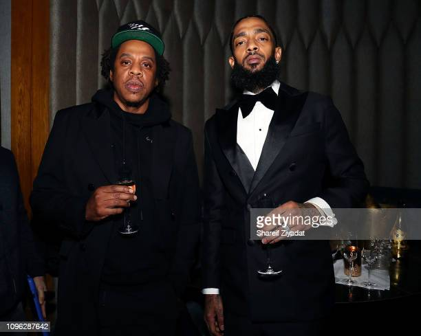 Shawn 'Jay-Z' Carter and Nipsey Hussle attend Nipsey Hussle Grammy Celebration at The Peppermint Club on February 8, 2019 in Los Angeles, California.