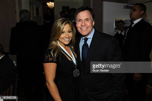 Shawn Johnson and Bob Costas attend the 28th Annual Great Sports Legends Dinner to Benefit The Buoniconti Fund To Cure Paralysis at The...