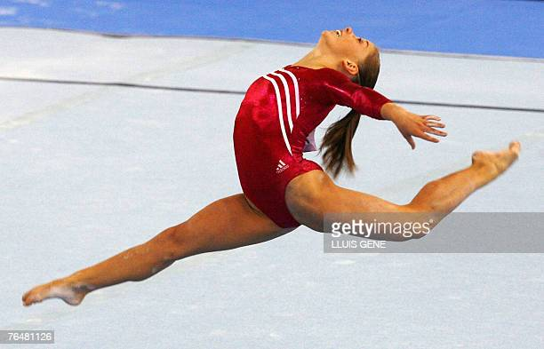 Shawn Johnson of the US performs on the floor during the women's qualifications of the 40th World Artistic Gymnastics Championships 02 September 2007...