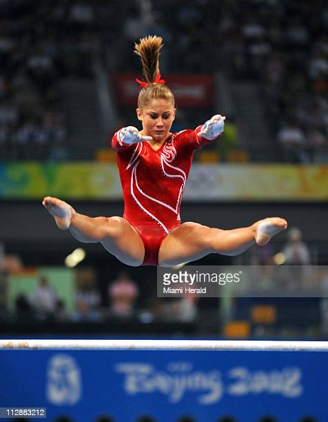 Shawn Johsnson of the United States competes on the uneven bars in the women's team final on Wednesday August 13 in the Games of the XXIX Olympiad in...