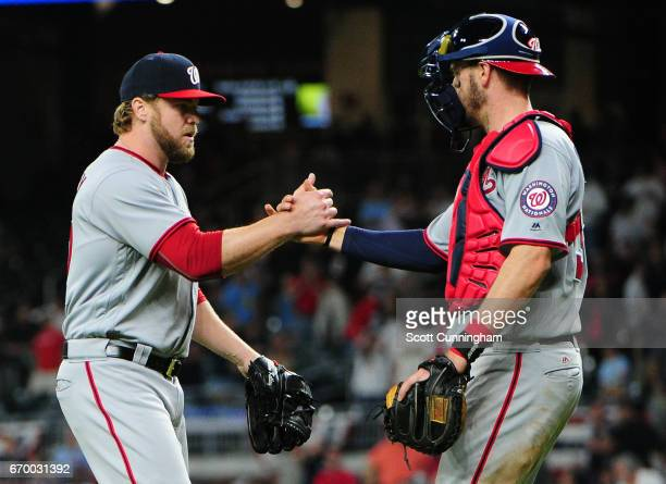 Shawn Kelley and Matt Wieters of the Washington Nationals celebrate after the game against the Atlanta Braves at SunTrust Park on April 18 2017 in...
