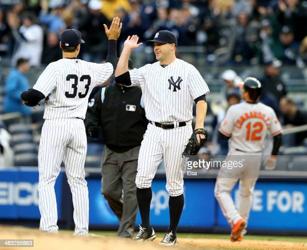 Shawn Kelley of the New York Yankees celebrates the win with teammate Kelly Johnson after the game against the Baltimore Orioles during the home...
