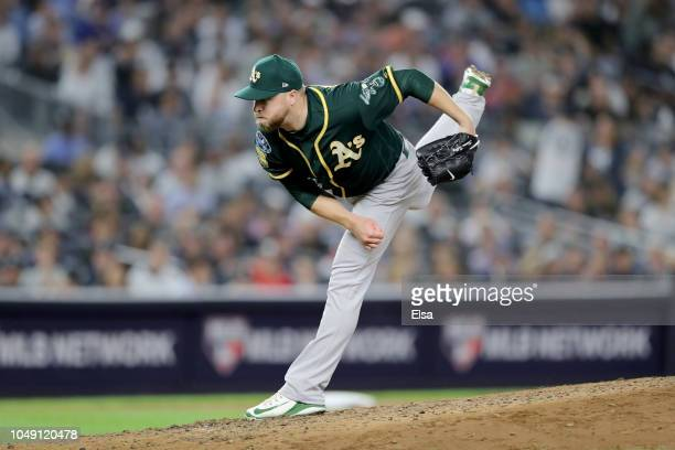 Shawn Kelley of the Oakland Athletics throws a pitch against the New York Yankees during the fifth inning in the American League Wild Card Game at...
