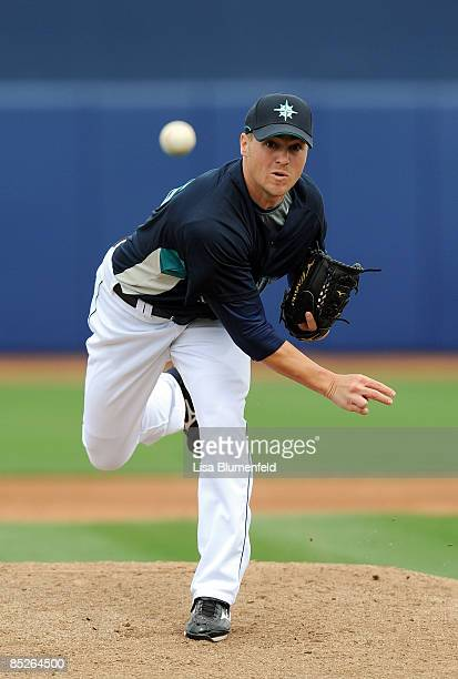 Shawn Kelley of the Seattle Mariners pitches during a Spring Training game against the Los Angeles Angels of Anaheim at Peoria Stadium on March 5...