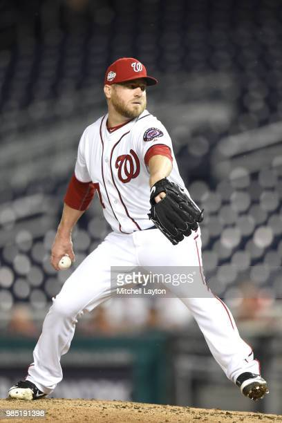 Shawn Kelley of the Washington Nationals pitches during a baseball game against the Baltimore Orioles at Nationals Park on June 20 2018 in Washington...