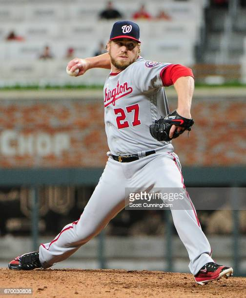 Shawn Kelley of the Washington Nationals throws a ninth inning pitch against the Atlanta Braves at SunTrust Park on April 18 2017 in Atlanta Georgia