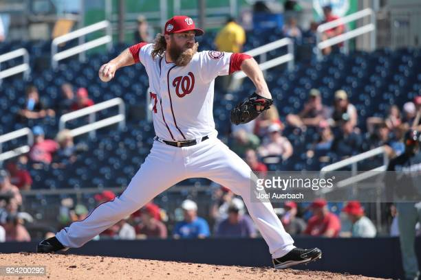 Shawn Kelley of the Washington Nationals throws the ball against the Atlanta Braves during the third inning of a spring training game at The Ballpark...