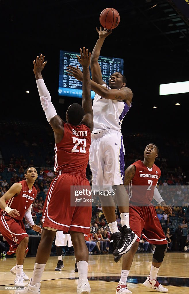 Shawn Kemp Jr. #40 of the Washington Huskies shoots over D.J. Shelton #23 of the Washington State Cougars in the first half during the first round of the Pac 12 Tournament at the MGM Grand Garden Arena on March 13, 2013 in Las Vegas, Nevada.