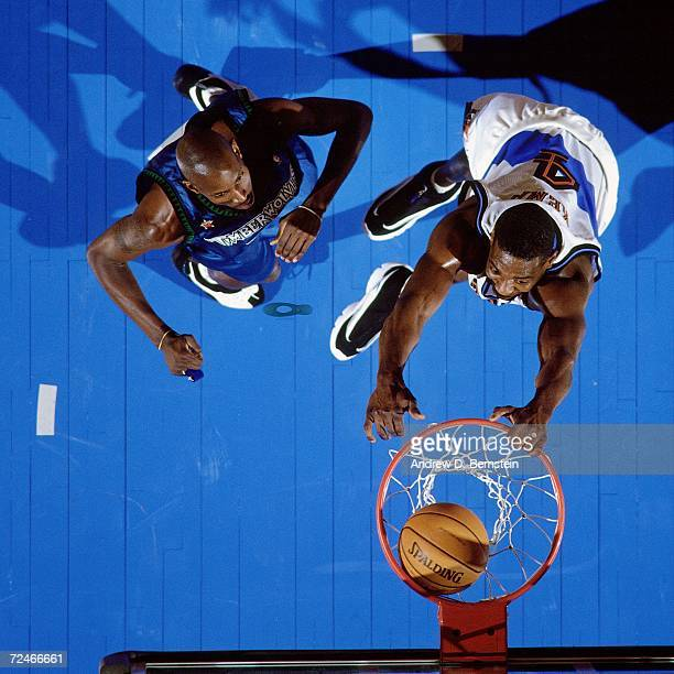 Shawn Kemp of the Eastern Conference AllStars throws down a dunk against Kevin Garnett of the Western Conference AllStars during the 1998 NBA AllStar...