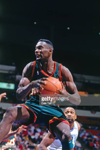 Shawn Kemp of the Seatte SuperSonics rebounds against the Minnesota Timberwolves circa 1996 at the Target Center in Minneapolis Minnesota NOTE TO...