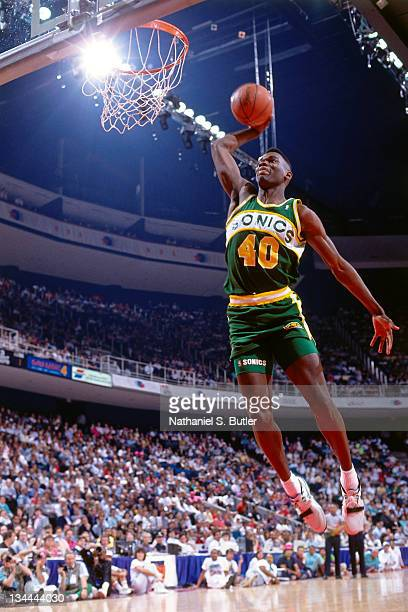 Shawn Kemp of the Seattle Supersonics attempts a dunk during the 1990 Slam Dunk Contest as part of AllStar Weekend on February 10 1990 at Miami Arena...