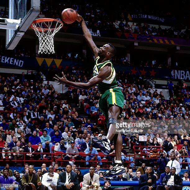 Shawn Kemp of the Seattle SuperSonics attempts a slam dunk during the 1994 Slam Dunk Contest on February 12 1994 at the Target Center in Minneapolis...