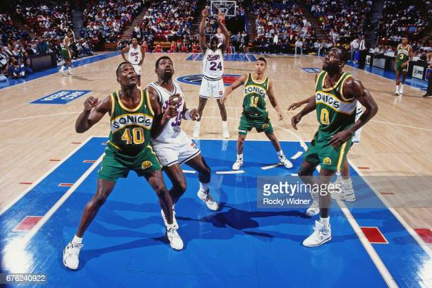 Shawn Kemp of the Seattle SuperSonics boxes out against the Sacramento Kings circa 1991 at Arco Arena in Sacramento California NOTE TO USER User...