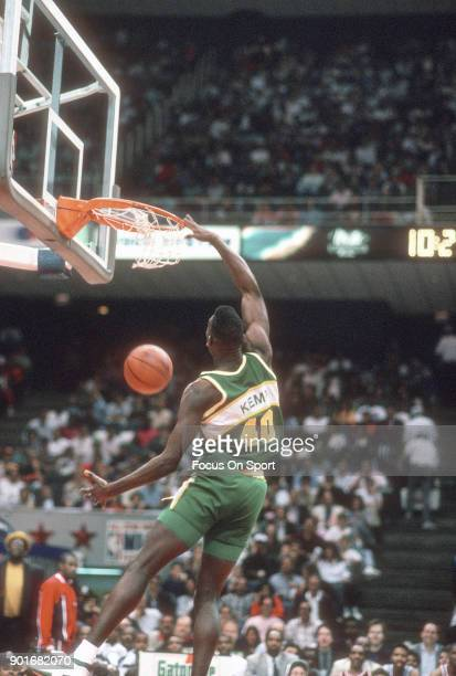 Shawn Kemp of the Seattle Supersonics competes in the slam dunk contest during NBA All Star Weekend on February 10 1990 at the Miami Arena in Miami...