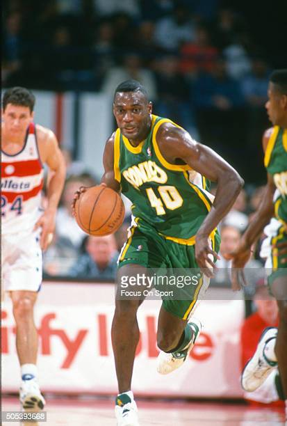 Shawn Kemp of the Seattle Supersonics dribbles the ball up court against the Washington Bullets during an NBA basketball game circa 1993 at US...