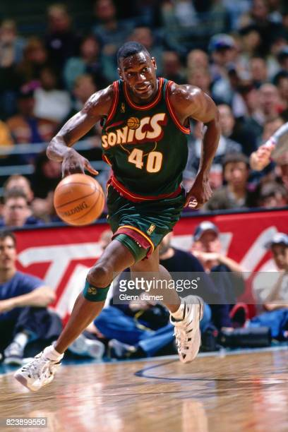 Shawn Kemp of the Seattle SuperSonics dribbles the ball up court against the Dallas Mavericks at the Reunion Arena in Dallas Texas crica 1997 NOTE TO...