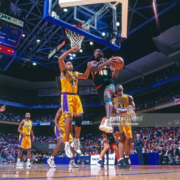 Shawn Kemp of the Seattle SuperSonics drives against the Los Angeles Lakers on October 25 1996 at the Great Western Forum in Inglewood California...
