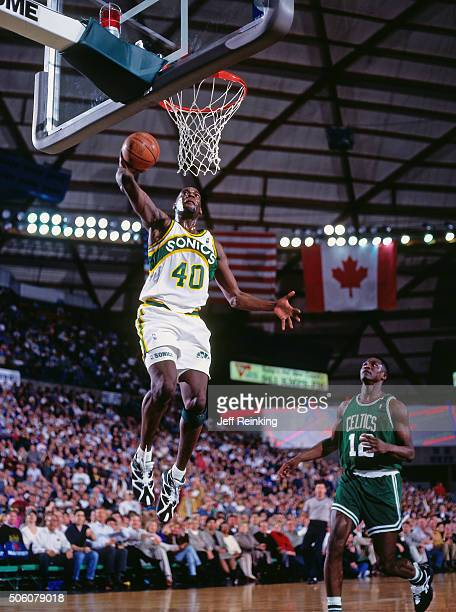 Shawn Kemp of the Seattle Supersonics dunks against the Boston Celtics circa 1995 at Key Arena in Seattle Washington NOTE TO USER User expressly...