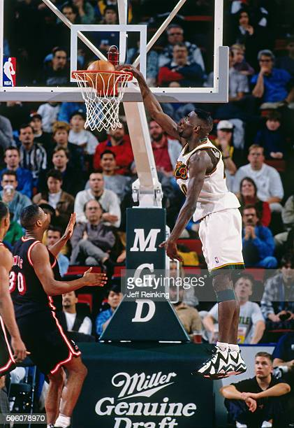 Shawn Kemp of the Seattle Supersonics dunks against the Miami Heat circa  1996 at Key Arena f26150abb