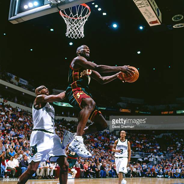 Shawn Kemp of the Seattle Supersonics dunks against the Minnesota Timberwolves during a game played circa 1997 at the Target Center in Minneapolis...