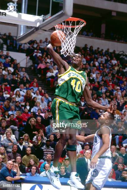Shawn Kemp of the Seattle SuperSonics dunks against the Minnesota Timberwolves circa 1994 at the Target Center in Minneapolis Minnesota NOTE TO USER...