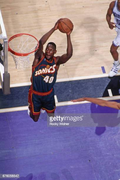 Shawn Kemp of the Seattle SuperSonics dunks against the Sacramento Kings circa 1995 at Arco Arena in Sacramento California NOTE TO USER User...