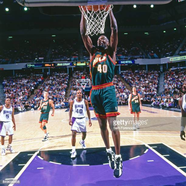 Shawn Kemp of the Seattle SuperSonics dunks circa 1996 at Arco Arena in  Sacramento California NOTE 457364543