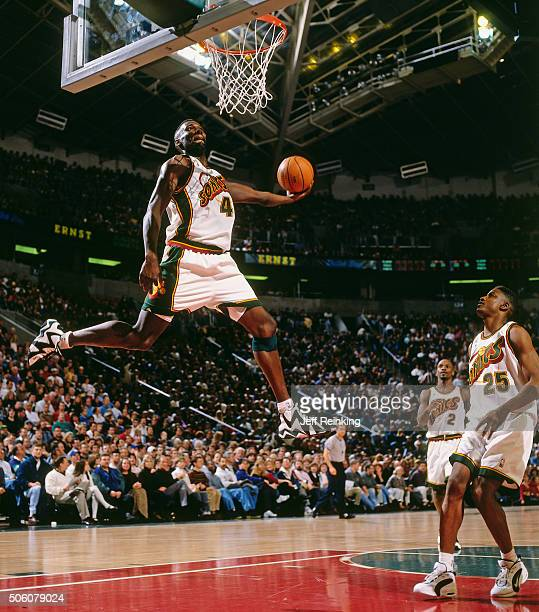 Shawn Kemp of the Seattle Supersonics dunks during a game circa 1996 at Key Arena in Seattle Washington NOTE TO USER User expressly acknowledges and...