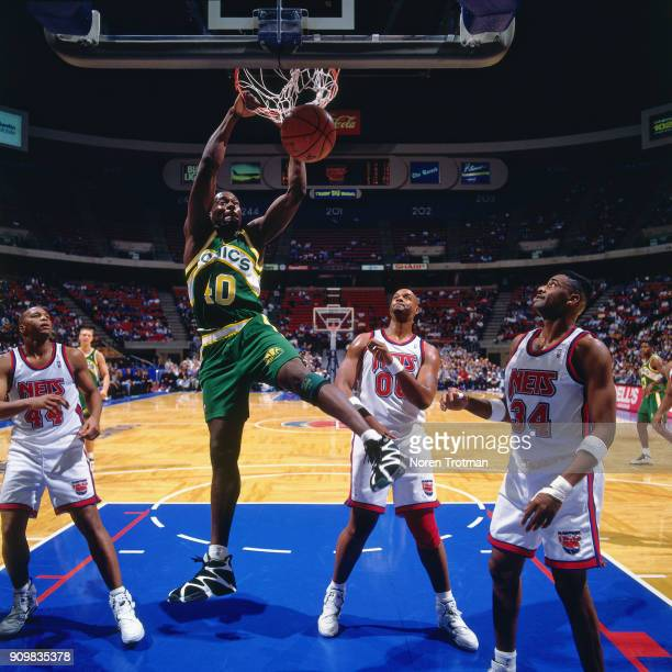 Shawn Kemp of the Seattle SuperSonics dunks during a game played on November 15 1994 at the Continental Airlines Arena in East Rutherford New Jersey...