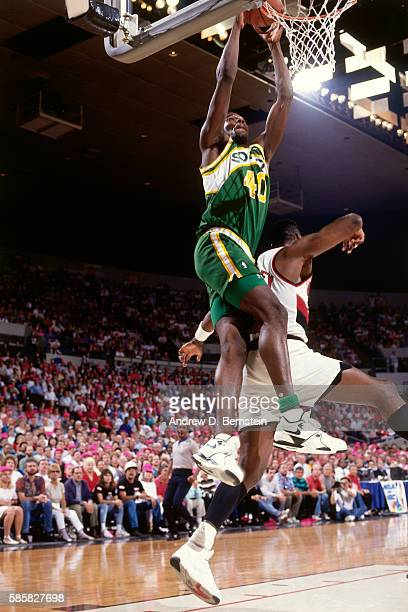 Shawn Kemp of the Seattle SuperSonics dunks the ball against the Portland Trail Blazers during a game at Memorial Coliseum in Portland Oregon circa...