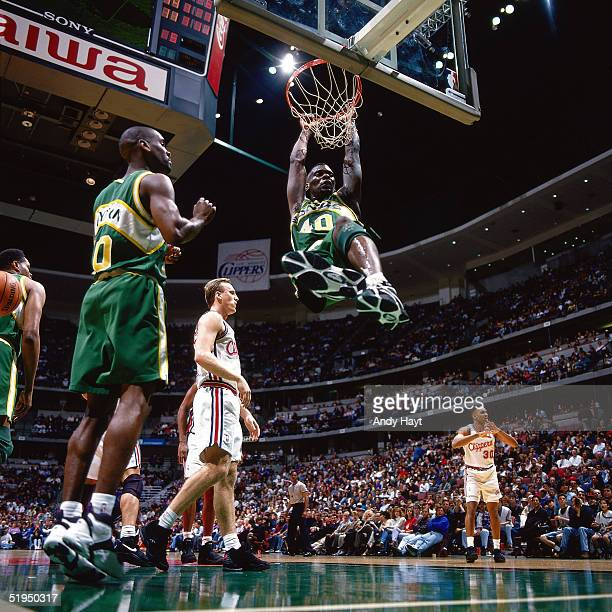 Shawn Kemp of the Seattle Supersonics goes for a dunk against the Los Angeles Clippers during the NBA game on March 2 1995 in Los Angeles California...