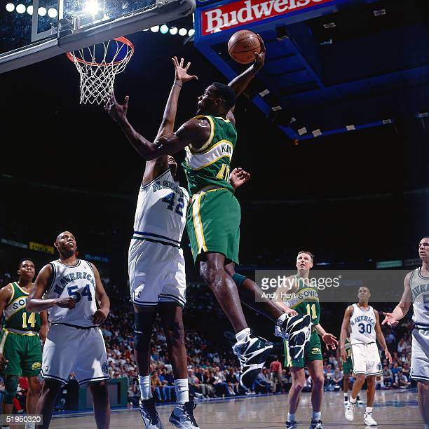 Shawn Kemp of the Seattle Supersonics goes for a dunk against the Dallas Mavericks during the NBA game on April 8 1995 in Dallas Texas NOTE TO USER...