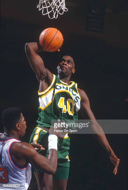 Shawn Kemp of the Seattle Supersonics goes up for a slam dunk over Patrick Ewing of the New York Knicks during an NBA basketball game circa 1991 at...