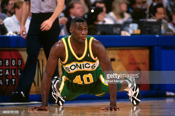 Shawn Kemp of the Seattle Supersonics lays on the court against the Golden State Warriors during a game played circa 1995 at the Oakland Coliseum in...