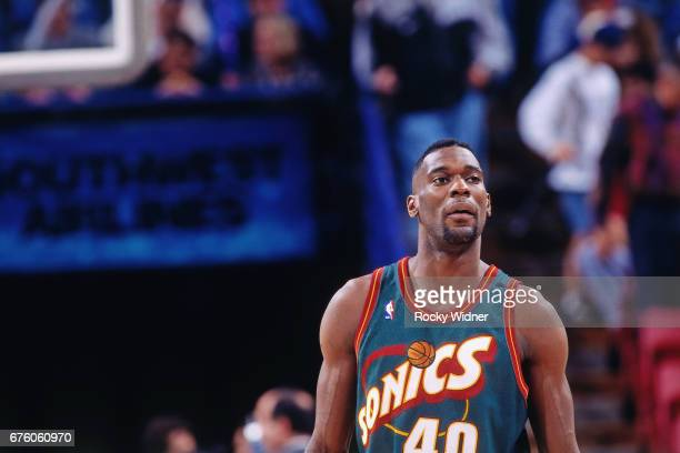 Shawn Kemp of the Seattle SuperSonics looks on against the Sacramento Kings circa 1995 at Arco Arena in Sacramento California NOTE TO USER User...