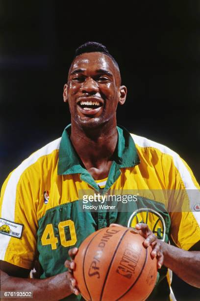 Shawn Kemp of the Seattle SuperSonics looks on against the Sacramento Kings circa 1992 at Arco Arena in Sacramento California NOTE TO USER User...