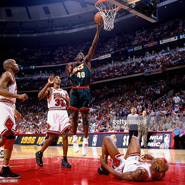 Shawn Kemp of the Seattle SuperSonics shoots a layup against Scottie Pippen of the Chicago Bulls during Game Six of the 1996 NBA Finals at the United...