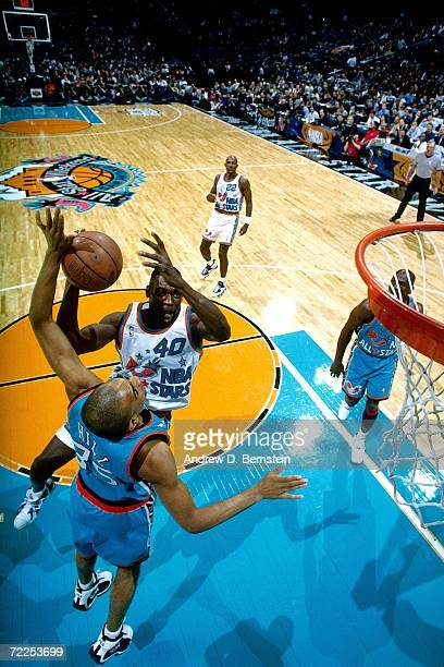 Shawn Kemp of the Western Conference AllStars drives to the basket against Grant Hill of the Eastern Conference AllStars during the 1996 NBA AllStar...