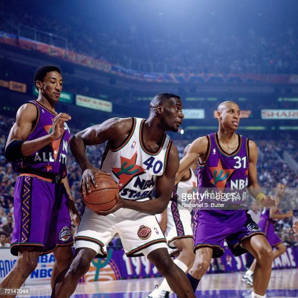 Shawn Kemp of the Western Conference All-Stars makes a move to basket against Reggie Miller and Scottie Pippen of the Eastern Conference All-Stars...