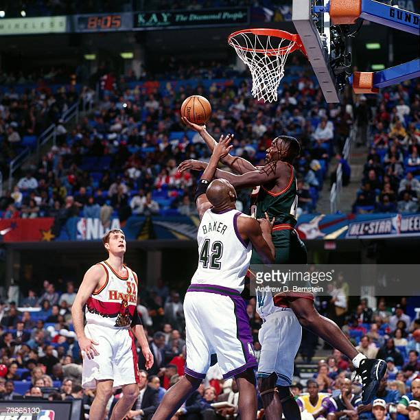 Shawn Kemp of the Western Conference shoots against Vin Baker of the Eastern Conference during the 1997 AllStar Game on February 9 1997 at Gund Arena...