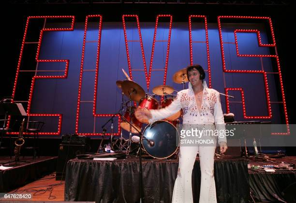 Shawn Klush of Franklin Tennessee poses on stage after he was declared winner in The Ultimate Elvis Tribute Artist Contest 17 August 2007 in Memphis...