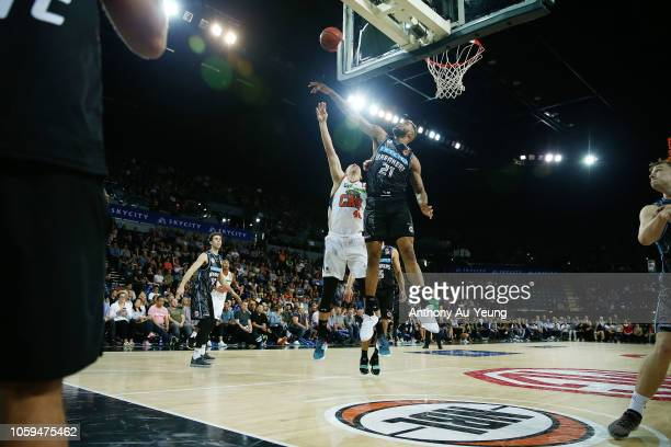 Shawn Long of the Breakers blocks the shot from Alex Loughton of the Taipans during the round five NBL match between the New Zealand Breakers and the...