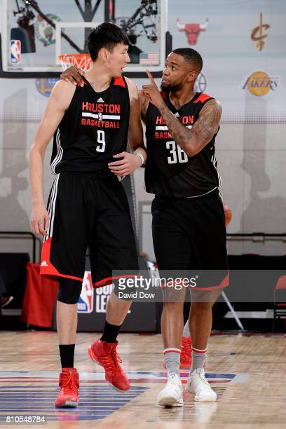 Shawn Long of the Houston Rockets talks with Zhou Qi of the Houston Rockets during the game against the Denver Nuggets during the 2017 Las Vegas...