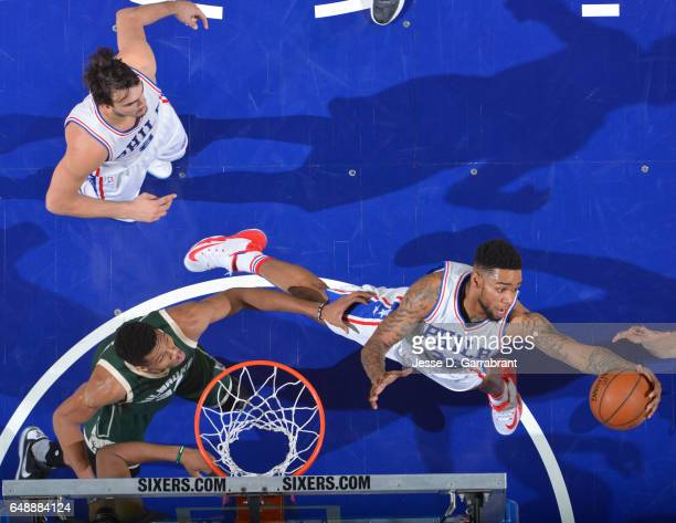 Shawn Long of the Philadelphia 76ers grabs the rebound against the Milwaukee Bucks at Wells Fargo Center on March 6 2017 in Philadelphia Pennsylvania...