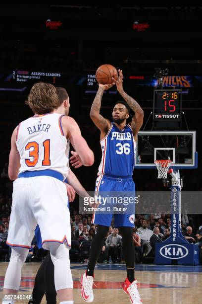 Shawn Long of the Philadelphia 76ers shoots the ball against the New York Knicks on April 12 2017 at Madison Square Garden in New York City New York...